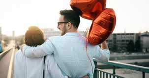 Romantic couple in love dating in sunset outdoor. Romantic couple in love dating and smiling in sunset outdoor Royalty Free Stock Images