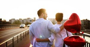 Romantic couple in love dating in sunset outdoor. Romantic couple in love dating and smiling in sunset outdoor Royalty Free Stock Image