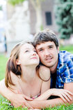 Romantic couple in love embracing lying outdoors Royalty Free Stock Image