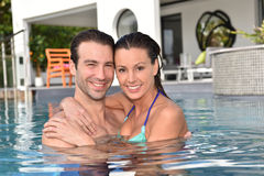 Romantic couple in love embracing in pool. In love couple embracing in swimming-pool Royalty Free Stock Photography