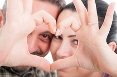 Romantic couple in love gesturing a heart Royalty Free Stock Image