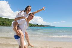 Romantic  couple in love  have fun on the beach with heart drawi Royalty Free Stock Images