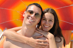 Romantic  couple in love  have fun on the beach with heart drawi Stock Photos