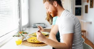 Couple in love having breakfast at home. Romantic couple in love having breakfast at home stock photos