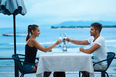 Romantic Couple In Love Having Dinner At Sea Beach Restaurant Royalty Free Stock Images