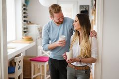 Romantic couple in love at home drinking coffee and smiling Royalty Free Stock Image