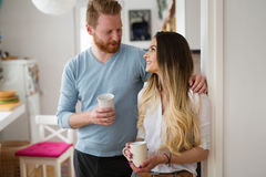 Romantic couple in love at home drinking coffee and smiling. Romantic couple in love at home drinking coffee Stock Photo