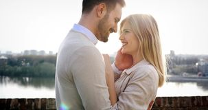 Romantic couple dating in sunset stock photo