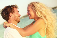 Romantic couple in love kissing happy at beach. Sunset. Young happy men and women on in romance on summer beach during honeymoon vacation holidays travel Stock Image