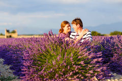 Romantic couple in love in lavender fields in royalty free stock image