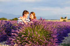 Romantic couple in love in lavender fields in Provence, France royalty free stock photography