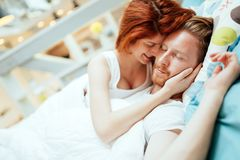 Romantic couple in love lying on bed Royalty Free Stock Images