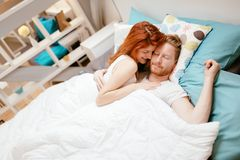 Romantic couple in love lying on bed Stock Photos
