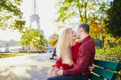 Romantic couple in love near the Eiffel tower stock photography