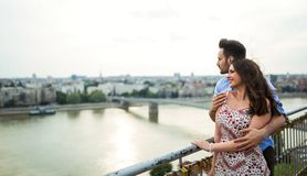 Romantic couple sightseeing and smiling royalty free stock images