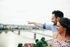 Romantic couple sightseeing and smiling royalty free stock photo