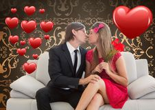 Romantic couple in love while sitting on a sofa Royalty Free Stock Photography