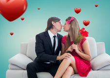 Romantic couple in love while sitting on a sofa Stock Photos