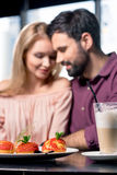 Romantic couple in love spending time together on coffee break in restaurant Royalty Free Stock Photos