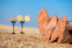 Romantic couple lying on a beach Stock Photos