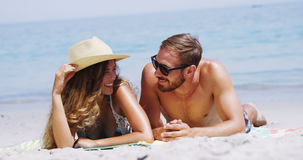 Romantic couple lying on beach. During summer stock video footage