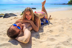 Romantic couple lying at the beach Royalty Free Stock Photo