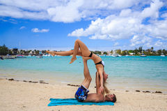 Romantic couple lying at the beach Royalty Free Stock Images