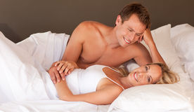 Romantic couple lying on a bed Royalty Free Stock Photo