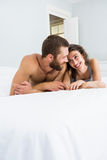 Romantic couple lying on bed Royalty Free Stock Images