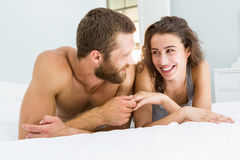 Romantic couple lying on bed Royalty Free Stock Image