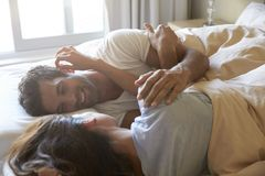 Romantic Couple Lying In Bed Together royalty free stock images
