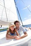 Romantic couple lying on a boat enjoying cruise Stock Images