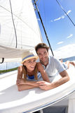 Romantic couple lying on a deck of sailing boat Royalty Free Stock Photos