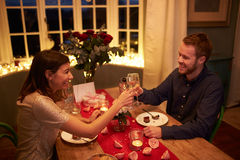 Romantic Couple Make A Toast At Valentines Day Meal Stock Photography