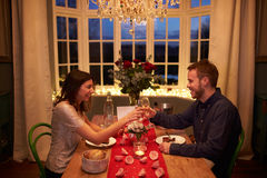Romantic Couple Make A Toast At Valentines Day Meal Stock Photos
