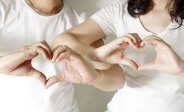 Romantic couple making heart shape Stock Images
