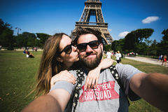 Romantic couple making selfie in front of Eiffel Stock Image