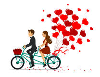 Romantic couple man and woman on a date driving bike with heart  balloons.  Royalty Free Stock Photography