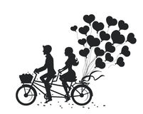 Romantic couple man and woman on a date driving bike