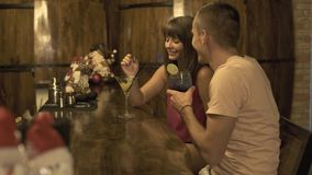 Romantic couple man and woman drinking cocktail at bar counter while meeting in restaurant. Young couple girlfriend and. Boyfriend drinking cocktail in cafe at stock footage