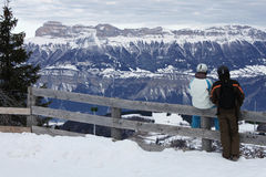 Romantic couple meditating the mountains. In winter Royalty Free Stock Photos