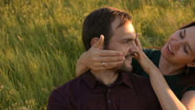 Romantic couple meets in the Park. The young woman closes her eyes on his boyfriend. stock footage