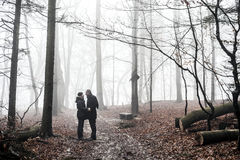 Romantic couple in misty forest Stock Photography