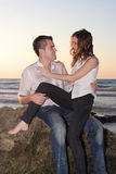 Romantic couple at nature. Romantic couple flirting at seaside royalty free stock photography