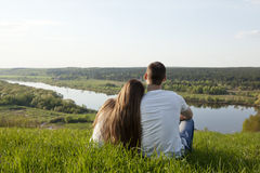 Romantic couple on the nature. Romantic couple looks at a magic landscape Royalty Free Stock Images