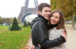 Romantic couple near the Eiffel Tower. Young romantic couple near the Eiffel Tower in Paris stock photo