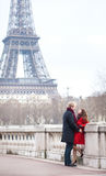 Romantic couple near the Eiffel Tower in Paris. Romantic couple in love dating near the Eiffel Tower in Paris Royalty Free Stock Photo