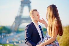 Romantic couple near the Eiffel tower in Paris Stock Photo