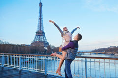 Romantic couple near the Eiffel tower in Paris, France royalty free stock photo