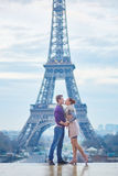 Romantic couple near the Eiffel tower in Paris, France Stock Images